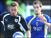 Bristol City striker Lee Trundle is challenged by Cardiff defender Roger Johnson