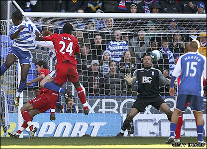 Reading's Andre Bikey glances a header beyond Maik Taylor