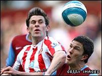 Sunderland's Daryl Murphy challenges Aston Villa defender Craig Gardner
