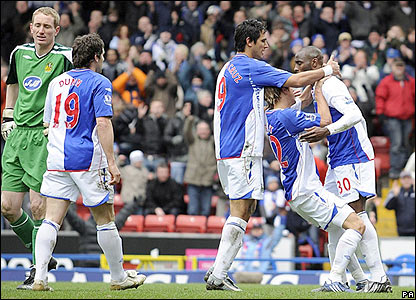 Jason Roberts is congratulated by his Blackburn team-mates