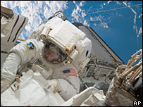 A Nasa image shows astronaut Robert Behnken during Endeavour's fourth spacewalk, 20 March 2008