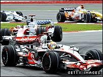 Lewis Hamilton's McLaren and Jarno Trulli's Toyota during the Malaysian Grand Prix