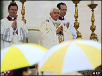 Pope Benedict XVI celebrates an open-air Easter Mass in a rainy St Peter's Square in Rome on Sunday