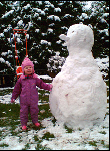 Phoebe with snowman. Copyright: Phil Wood
