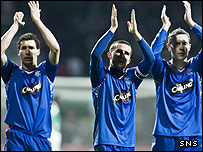 Rangers players clap the fans who travelled to Bremen