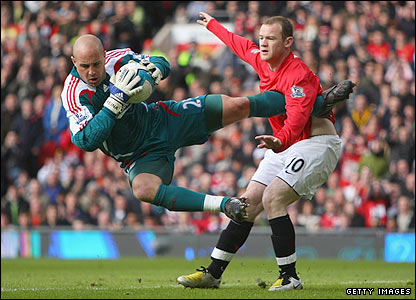 Pepe Reina claims the ball under pressure from United's Wayne Rooney