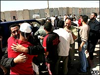 Released Palestinian prisoners are greeted by relatives after crossing the Rafah border point into the Gaza Strip.