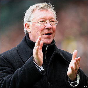 Sir Alex Ferguson celebrates