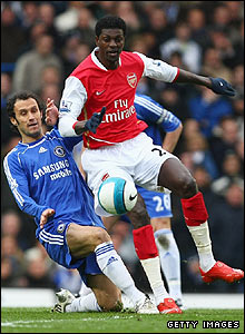 Ricardo Carvalho tackles Arsenal's Emmanuel Adebayor