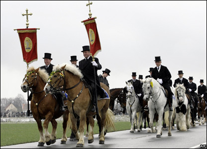 Men ride decorated horses in an Easter procession in Ralbitz, Germany