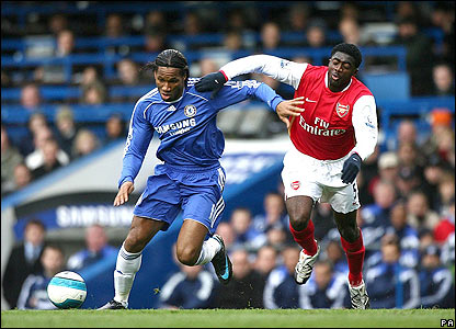 Didier Drogba battles to break free from Arsenal defender Kolo Toure