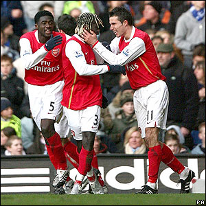 Bacary Sagna is congratulated by his team-mates