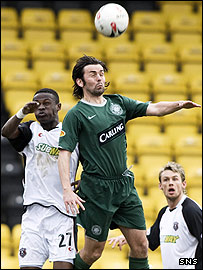 Paul Hartley beats Gretna's Abdul Osman to the ball