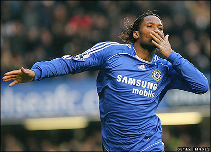 Drogba celebrates scoring the winner