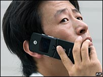 Man uses mobile phone in Beijing