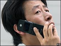Man uses mobile phone in Beijing