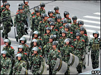 Chinese soldiers patrol along a street in Kangding, Sichuan (23rd March)