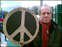 Christopher Holden with the original placard he took as a 15-year-old to the march in 1958