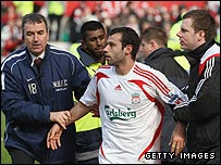 Javier Mascherano (centre) had to be escorted from the pitch