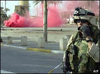 A US soldier secures an area in Baghdad after finding an improvised explosive device (IED). Photo: 2004