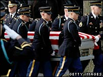 An US honour guard carries a casket of US soldier killed in Iraq during a burial service in Arlington, Virginia. Photo: 14 March 2008