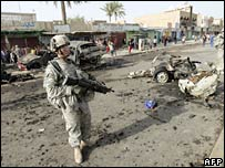 US troops secure the site of a car bomb in Baghdad on 23 March 2008