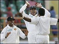 Michael Vandort and Chaminda Vaas celebrate a wicket