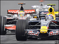 Mark Webber holds off Lewis Hamilton during the Malaysian Grand Prix