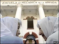Two members of the Mothers of the Plaza de Mayo organisation gather outside Esma on 24 March