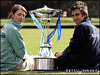 Cambridge's Rebecca Dowbiggin and Oxford's Nick Brodie pose with the Boat Race trophy