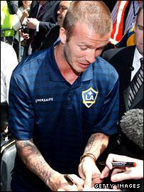 David Beckham signing autograph