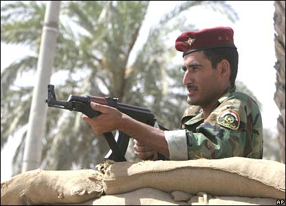 An Iraqi police officer mans a checkpoint in Basra, Iraq (25/03/08)