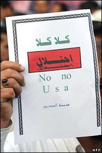 "An Iraqi Sadrist carries a sign reading ""No, no occupation"" in Arabic as he joins demonstrators in Najaf (25/03/08)"