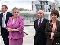 (L to R) Nicol Stephen, Annabel Goldie, Sir Kenneth Calman and Wendy Alexander walking outside the Scottish Parliament