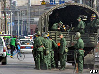 Chinese soldiers disembark from a truck in Lhasa on 21 March 2008