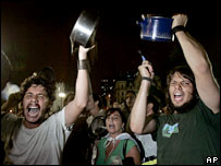 Demonstrators in Buenos Aires bang saucepans in protest at a rise in taxes on commodities