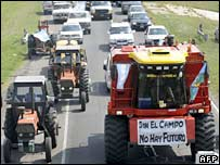Tractors block a main highway in Argentina on 19 March as [part of farmers' protests against tax rises