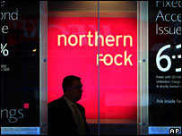 Man walks past a Northern Rock branch