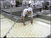 Buffalo mozzarella cheese is prepared at a dairy in Caserta, near Naples, southern Italy