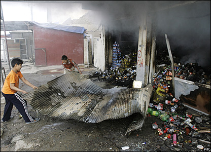 A burned shop at Jamila market in Sadr City on 26 March 2008