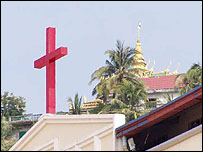Cross on top of Christian University of Cambodia with Pagoda in back ground