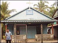 So Kom, a Cambodian convert in front of his church