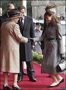 The Queen greets Carla Bruni-Sarkozy