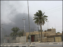 Smoke rises during clashes between  Mahdi Army and state forces in Basra