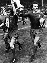 Tommy Smith and Brian Hall (left) celebrate Liverpool's 3-0 win over Newcastle in the 1974 FA Cup final