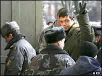 "Police escort members of the Belarus opposition movement ""Young Front"" into court in Minsk on March 26, 2008."