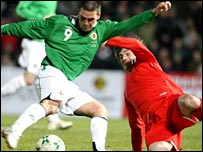 David Healy comes under pressure from Georgia's Levan Tskitishvili
