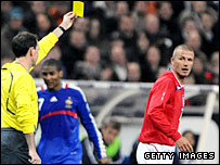 David Beckham gets a yellow card