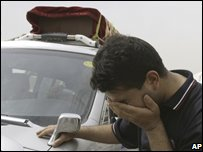A man cries for a relative killed in Baghdad