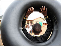 Children with a tire used to cross the river in Thuthukani Primary School playground (Photo: Gcina Ndwalane from The Mercury)